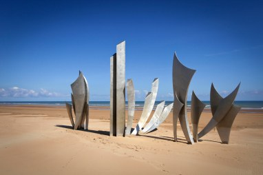 "The ""Les Braves"" monument at Omaha Beach."