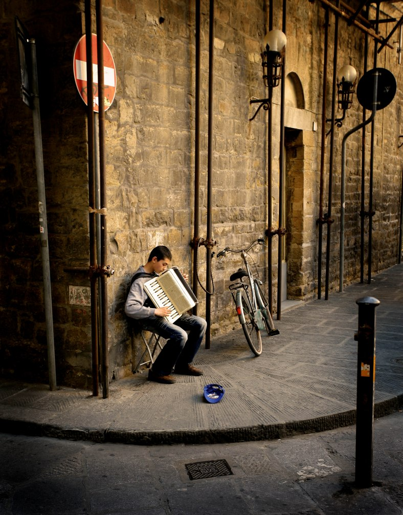 Street musician, Florence, Italy, playing accordian