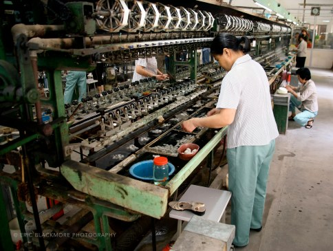 Women work on a silk spooling.reeling machine in the No.1 Silk Factory in Suzhou, China.