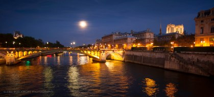 The Seine in the blue hour with full moon rising